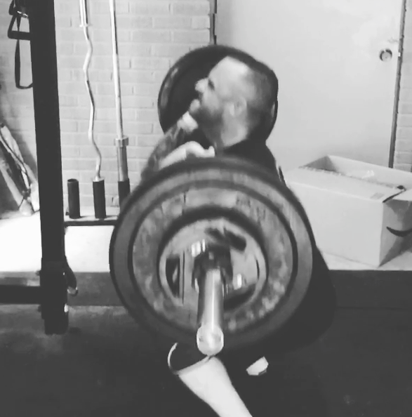 Brandon Richey Fitness strength student Jeremy performing front squat for athletic strength