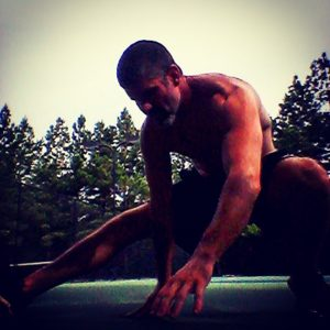 Brandon performing a cossack squat to stretch the inner thighs and adductors.