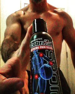 4 oz. CobraZol Sport Black Bottle being held in one hand for display by CobraZol Sports Ambassador Brandon Richey