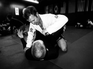 Black and white image of two men grappling in BJJ.